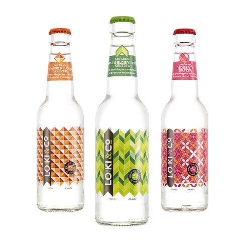 3 colourful bottles of Loki & Co hard seltzer in orange & mango, apple & elderflower, & red berry