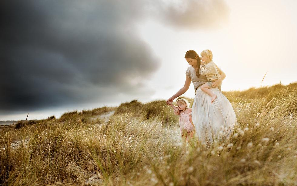 Mother & children on beach - Victoria Lugton