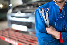 Hand of car mechanic with wrench. Auto repair garage..jpg