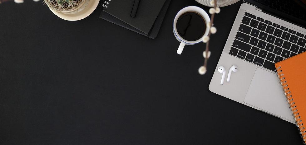 top-view-photo-of-coffee-cup-near-macboo