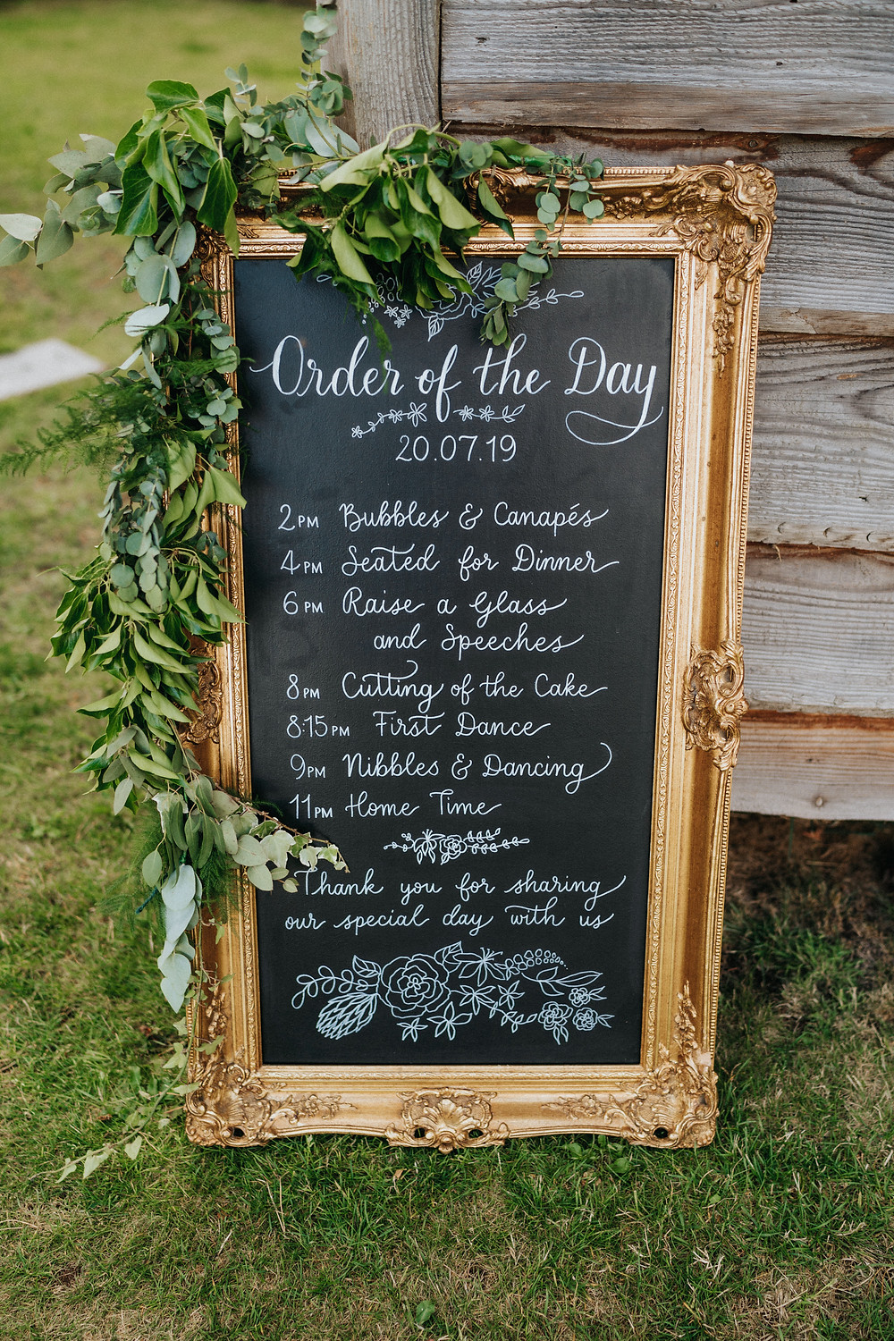 Order of the day calligraphy chalkboard for a wedding