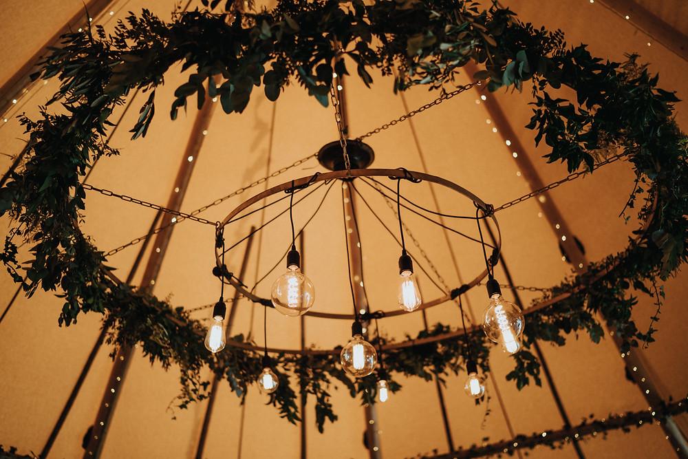 Eddison bulb chandelier tipi wedding