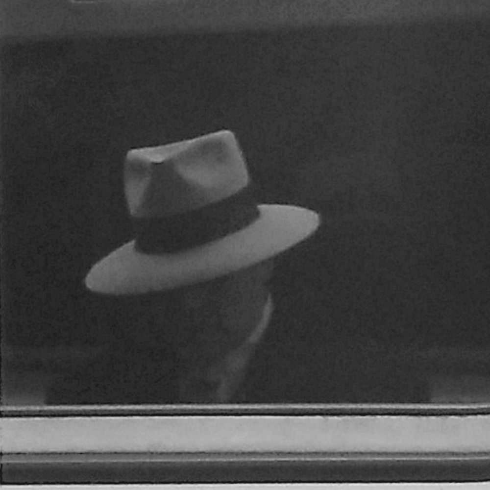 Man In White Hat