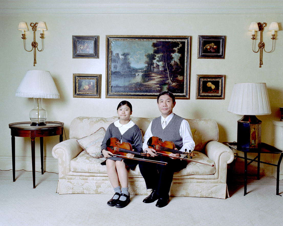 Father and daughter with violins