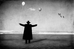 Man in Black with Balloons