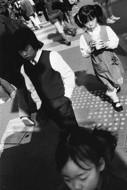 Children Walking Through Street