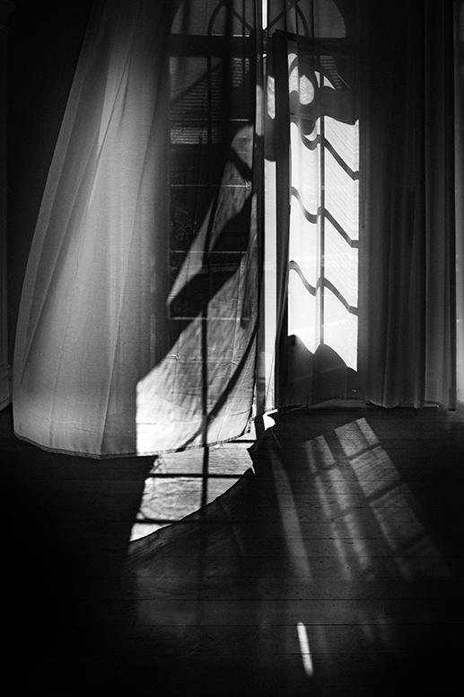 Harmony of curtain, wind, shadow and light