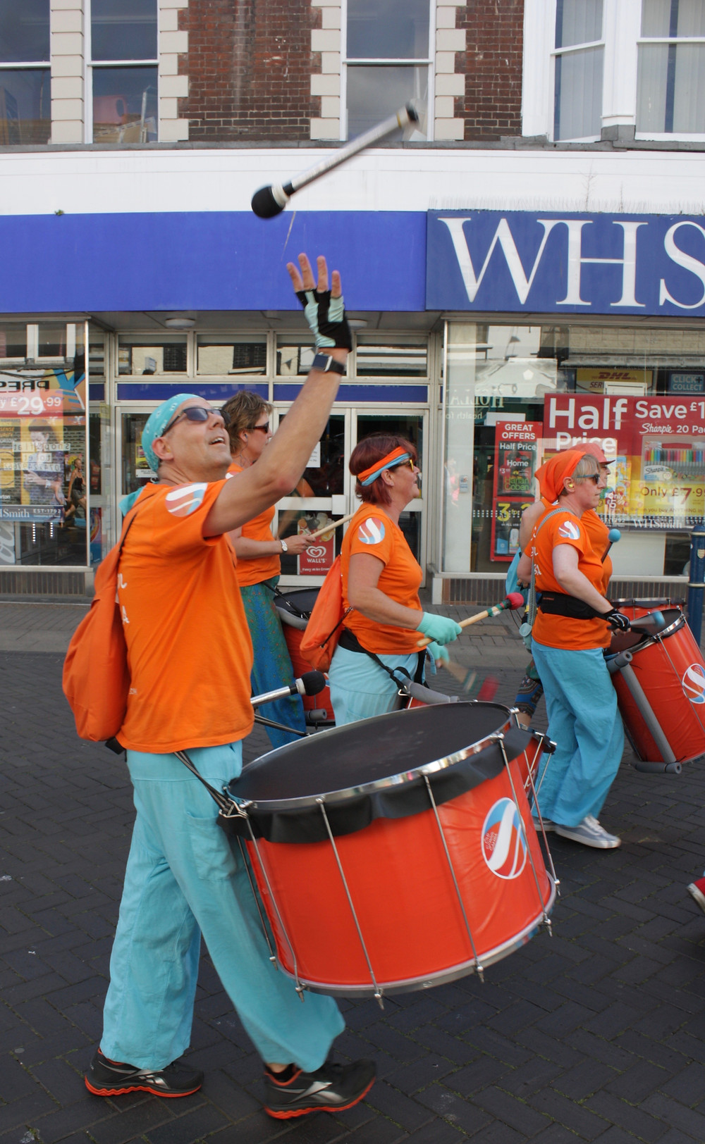 Old School Samba throwing sticks at Dover Town Carnival