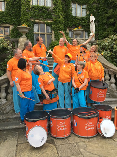 Old School Samba band on the steps of Eastwell Manor for a Big Cat Sanctuary Fundraiser event