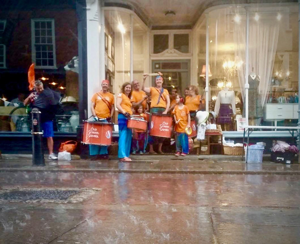 Old School Samba sheltering from the rain at the Demelza Rochester Festival