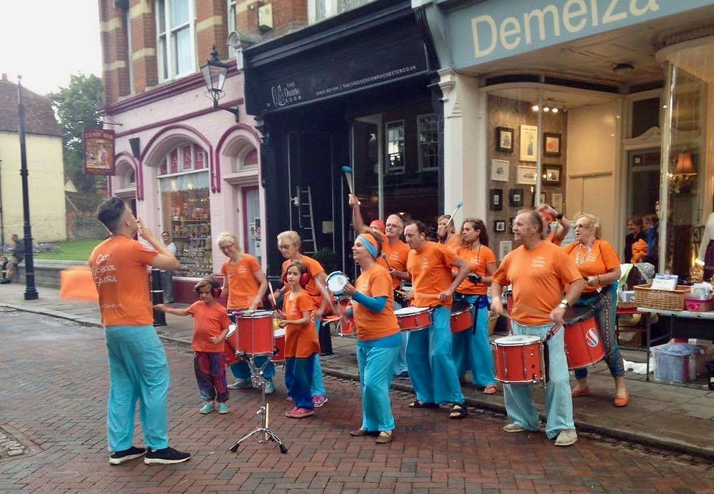 Old School Samba playing in the rain at the Demelza Rochester Festival