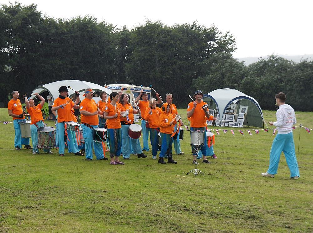 Old School Samba performing in the rain