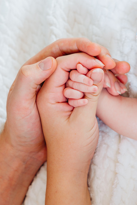 Mum Dad and Baby hands