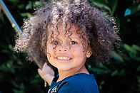 photo of beautiful smiling young girl with lots of curly hair