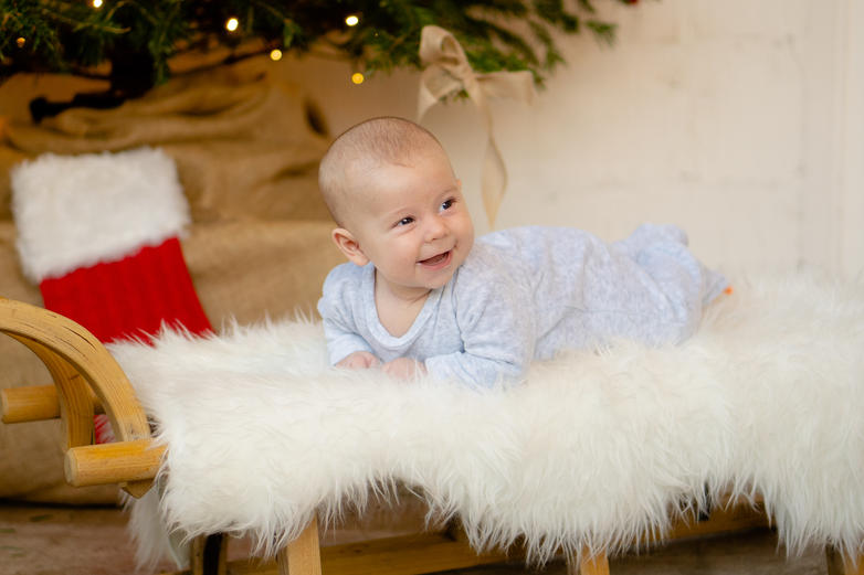 Christmas sledge baby portrait pose