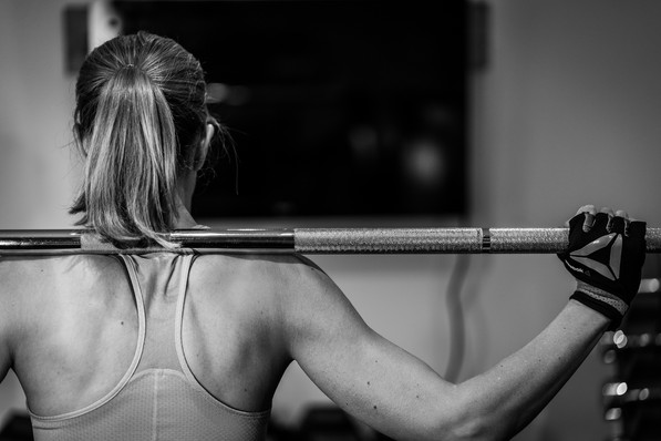 Personal trainer weight lifting