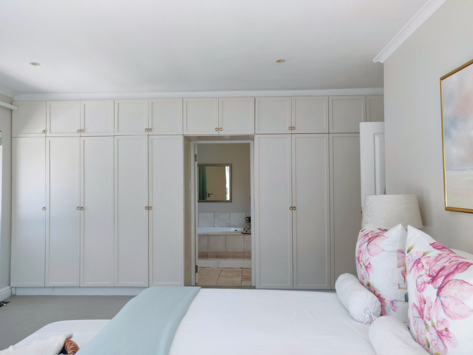 Master Bedroom with ample built-in cupboards
