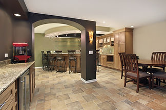 Lower level basement with bar and chairs