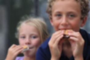 Boy and girl eating smores