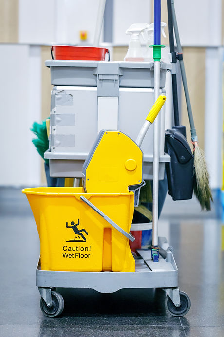 Yellow mop bucket and set of cleaning eq