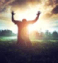 man_field_worship_praise_iStock-52368906