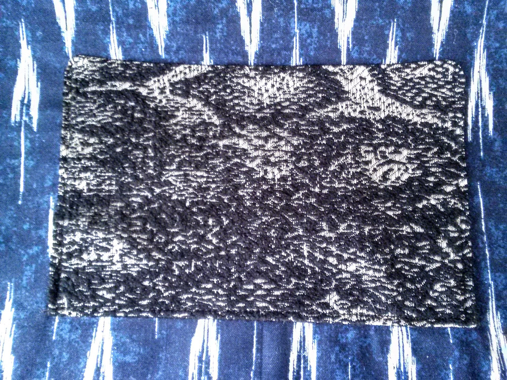 black, white, silver, gray snake pocket detail