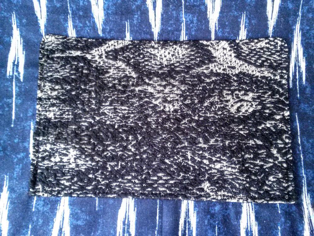 black, white, silver, gray snake pocket detail