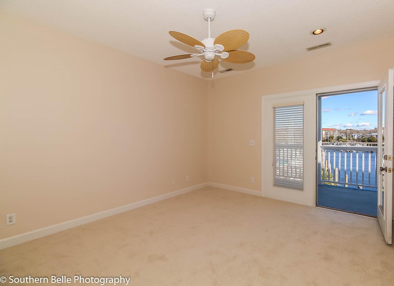 15. Master Bedroom with Balcony View of Intercoastal WM
