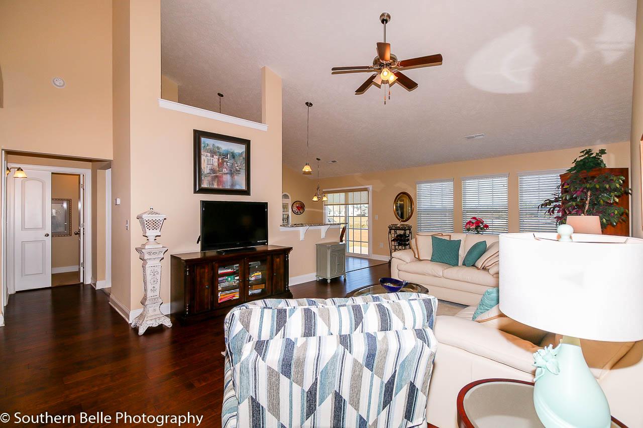 7. Formal Living Room- Kitchen- Master Bedroom View WM