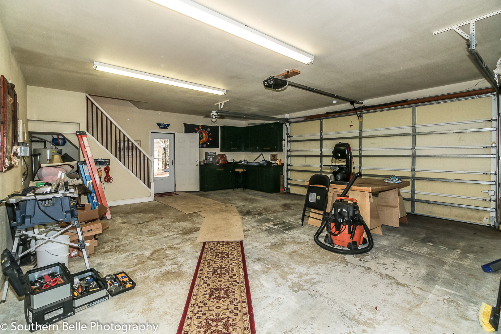 24. Garage with Access to Upper Loft Area & Has Built in WM