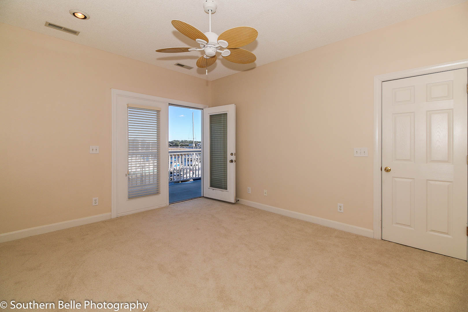 16. Master Bedroom with Balcony View of Intercoastal WM