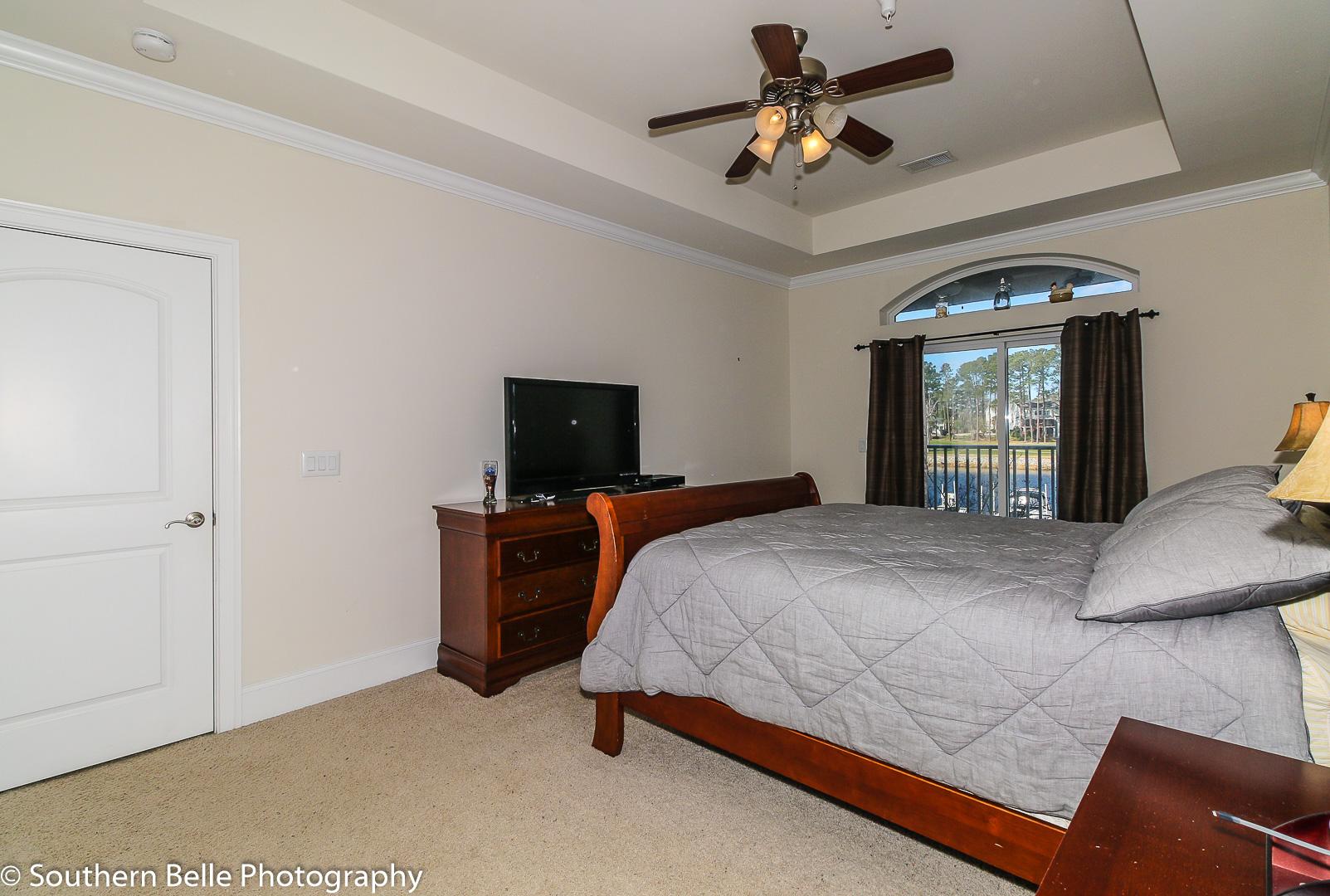 16. Master Bedroom W- Balcony Waterway View WM