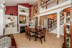 8.  Formal Dining Room with Built-ins & Fireplace WM
