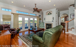 5. Formal Living Room with Waterway Views and Fireplace WM