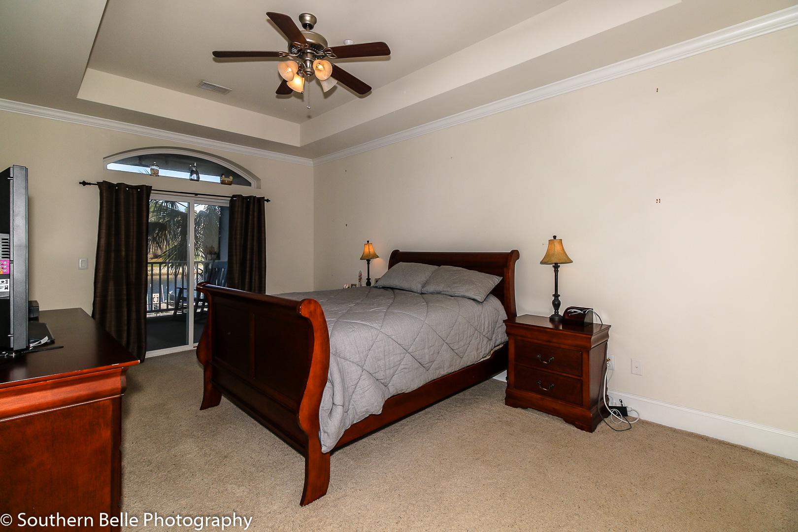 15. Master Bedroom W- Balcony Waterway View WM
