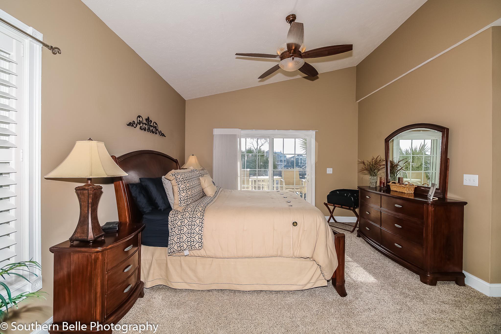 17. Master Bedroom W- Balcony Water Views WM