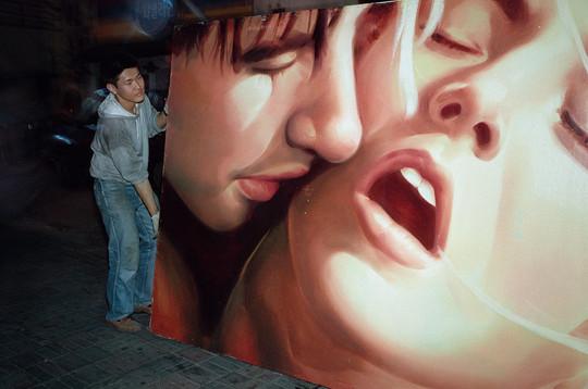 Allan Sekula, 'Worker instaling hand-painted billboard for American Movie.