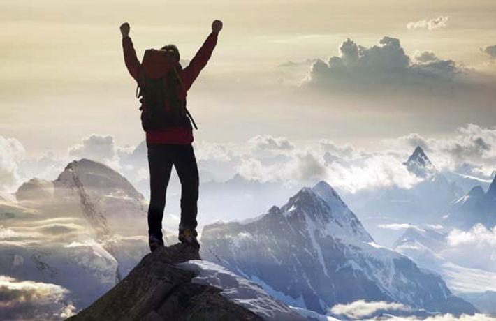 guy on mountain top.jpg
