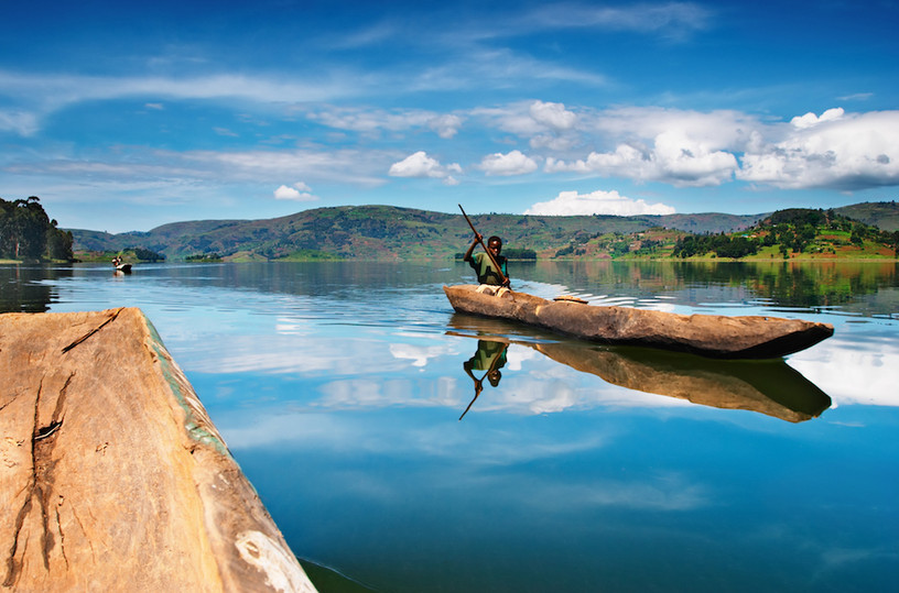 African boy in canoe, Lake Bunyoni