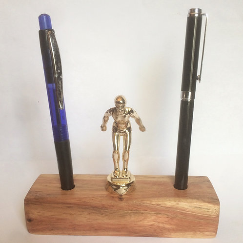 Pen holder with swimming trophy topper