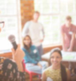 A new English teacher teaches a large group English class