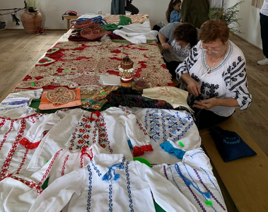 "Romanian artisans during a live show of the embroidery technique of the traditional ""IE"" blouse."