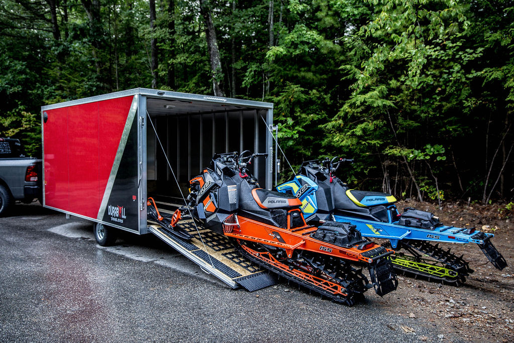 Multisport trailer with snowmobiles