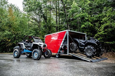 DuraBull MultiSport trailer with ATV on ramp and four wheeler next to trailer