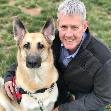 Inspirational Speaker and his Service Dog