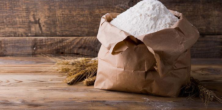 Wheat flour in Kraft paper bags. Paper p