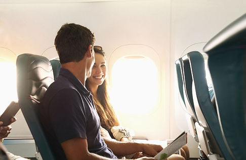 smiling-couple-sitting-on-airplane-70071