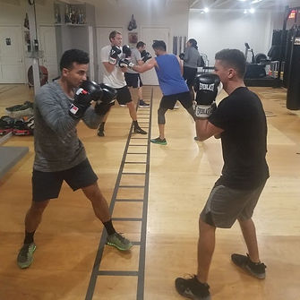 Boxing Level 2 class: Two male boxes