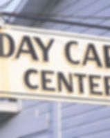 Low angle view of Day Care Center sign.j
