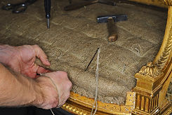 a restorer renews the upholstery of anti